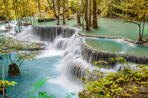 Staande foto Bos rivier Travel to the beautiful waterfall in tropical rain forest, soft water of the stream in the natural park at Huai Mae Khamin Waterfall in Kanchanaburi, Thailand.
