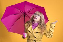 Woman With Open Umbrella On Ye...