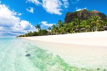 Beautiful View Of The Resort On Mauritius. Transparent Ocean, White Sand, Palms And Sky