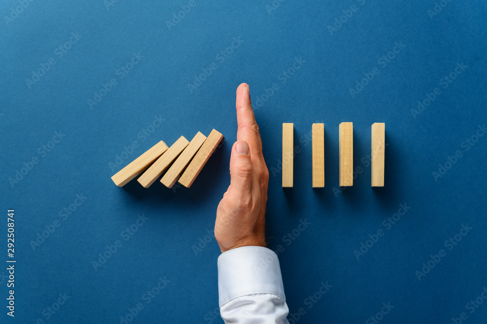Fototapeta View from above of male hand interfering collapsing dominos