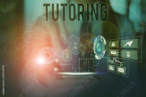 Valokuva  Conceptual hand writing showing Tutoring