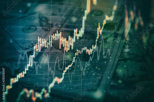 Fotomural  Charts of financial instruments with various type of indicators including volume analysis for professional technical analysis on the monitor of a computer
