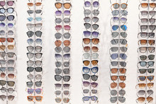 Many Different Sunglasses On D...