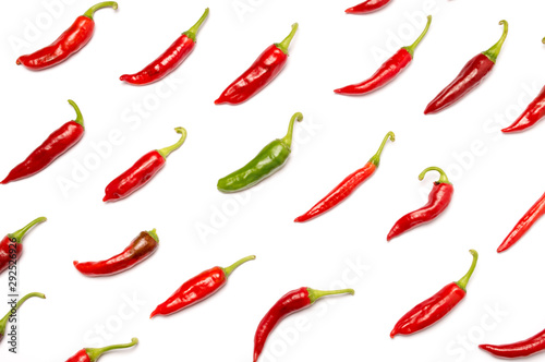 Texture of red hot chili peppers on white background. Individuality, originality and uniqueness concept
