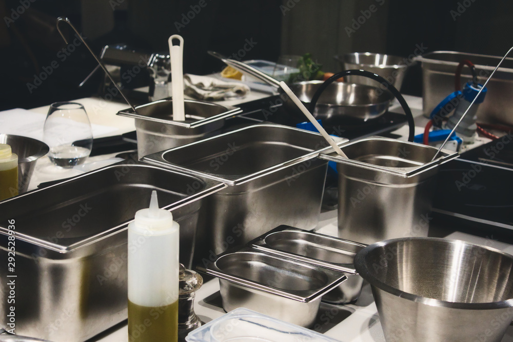Fototapety, obrazy: Stainless steel cooking containers in a professional kitchen