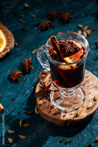 Poster Ecole de Danse A glass of mulled wine in a low key on a blue background with a hard light.