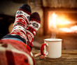 canvas print picture Fireplace and slim woman legs with christmas socks
