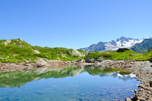 Beautiful Lac De Cheserys, Lake Cheserys Near Chamonix-Mont-Blanc In French Alps. Alpine Lake With Snow Capped Mountains In Background. France Mountain, Tour Du Mont Blanc. Amazing Landscapes