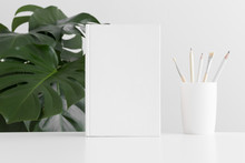 White Book Mockup With Workspace Accessories And A Monstera Plant.