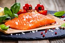 Fresh Raw Salmon Fillets On Black Stone Plate
