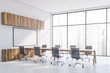 White panoramic conference room with poster