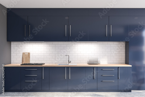 Gray and brick kitchen with blue countertops