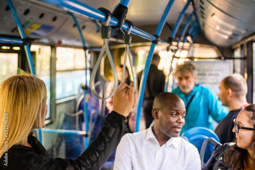 Man and woman talking in bus