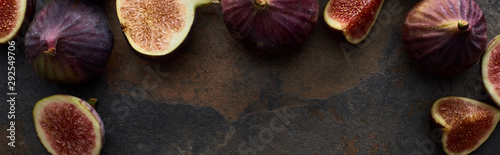 panoramic shot of ripe fresh whole and cut figs on stone textured background - 292549706