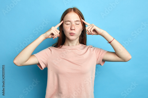 Fotografie, Obraz  depressed frustrated upset serious girl concentrated on thinking, trying to remember something, woman has terrible headache, girl massaging her temples