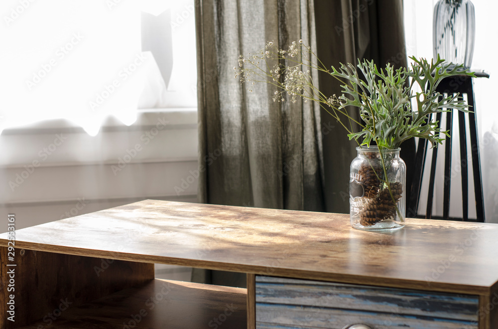 Fototapeta vase with a bouquet on the table by the window