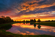 Beautiful Sunrise Clouds Over Golf Course And Lake