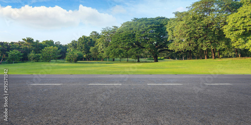 Fototapeta Empty highway asphalt road and beautiful sky in landscape green park obraz