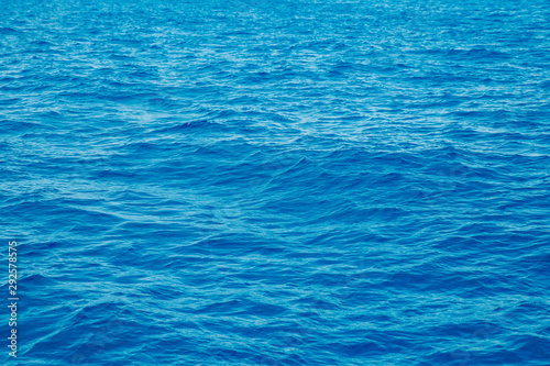 Poster Mer / Ocean Natural background blue sea with waves, azure clear water beach. Aerial top view