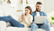 canvas print picture - Couple at home. Man with laptop, woman with phone
