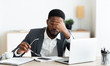 Leinwandbild Motiv Overworked businessman sitting at workplace after hard day in office