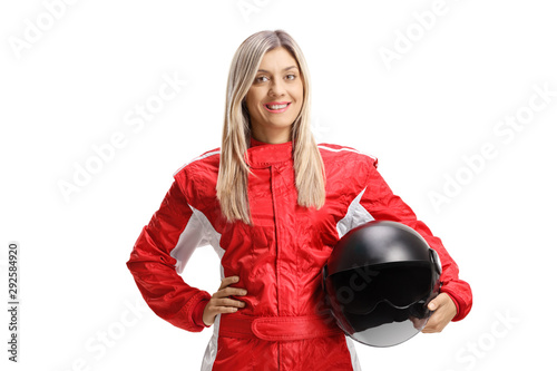Cuadros en Lienzo Young female racer holding a helmet