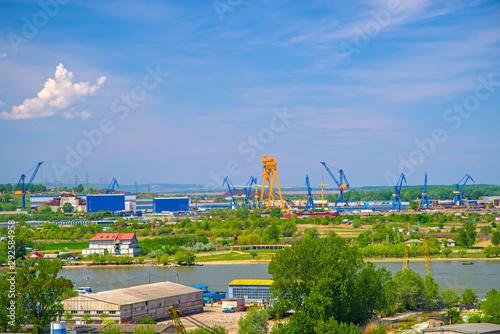 Tuinposter Rotterdam Industrial cargo port skyline, loading cranes