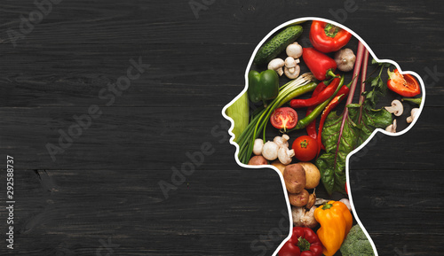 Woman with fresh vegetables in her body on wood - 292588737