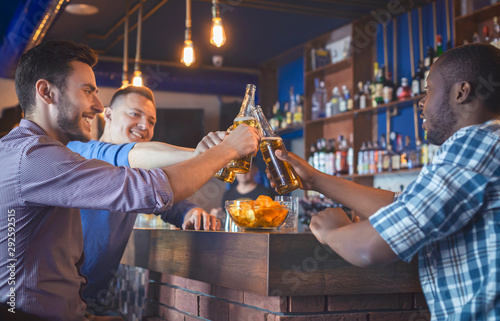 Canvas Prints Equestrian Happy Guys Clinking Beer Bottles In Bar