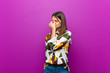 canvas print picture - young pretty woman feeling stressed, unhappy and frustrated, touching forehead and suffering migraine of severe headache against purple background