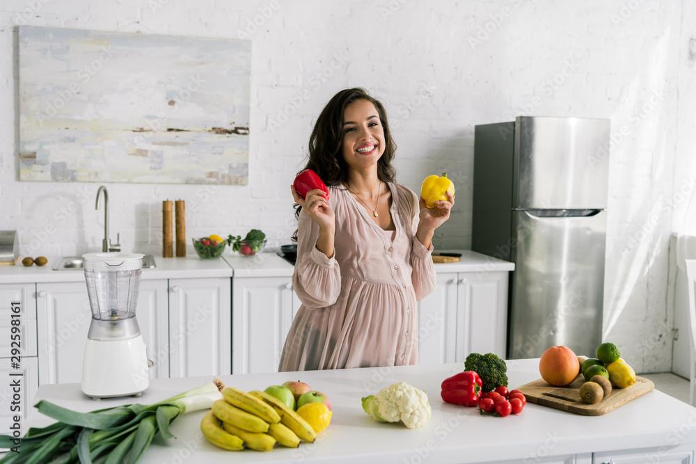 Fototapety, obrazy: happy young woman holding paprika near tasty food