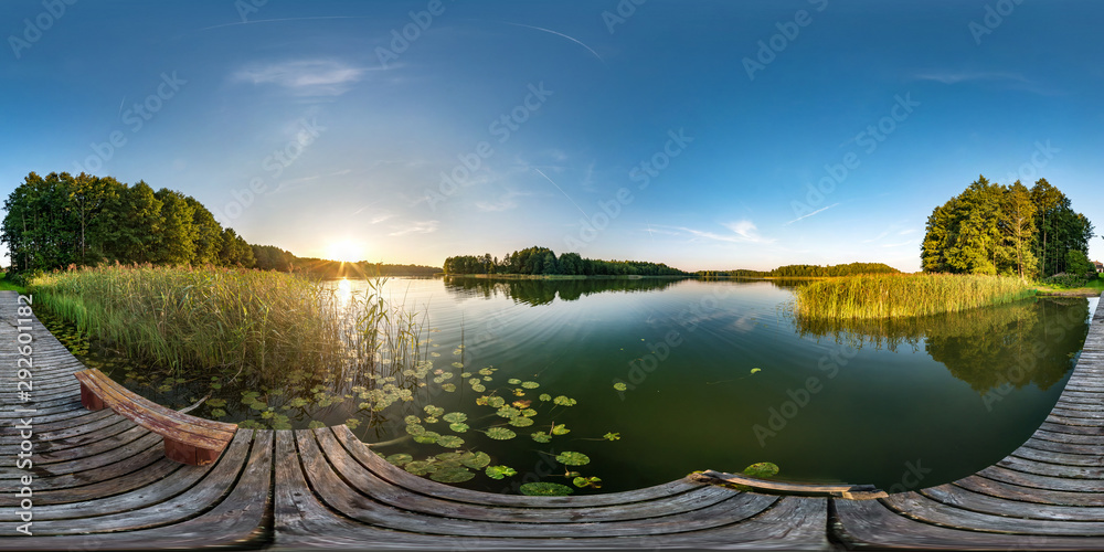 Fototapeta full seamless spherical hdri panorama 360 degrees angle view on wooden pier near lake in evening in equirectangular projection with zenith, ready VR AR virtual reality content