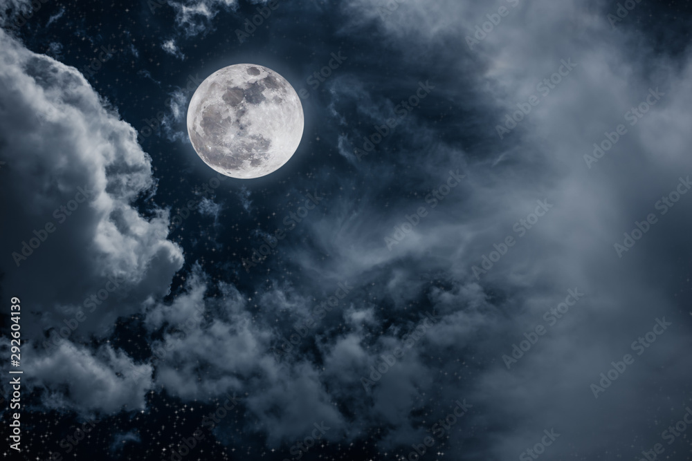 Fototapeta Night sky with bright full moon and cloudy, serenity nature background.