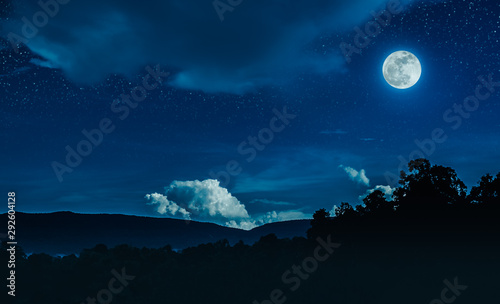 Foto auf Leinwand Blaue Nacht Landscape of blue night sky with many stars and beautiful full moon.