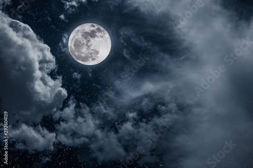 Fotobehang Zwart Night sky with bright full moon and cloudy, serenity nature background.
