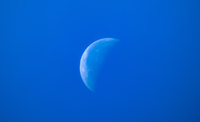 The Beautiful View of Moon in Blue Skies.
