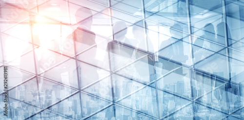 Photographie Double exposure image of faded business abstract background with office building and people conference group meeting showing partnership success of business deal