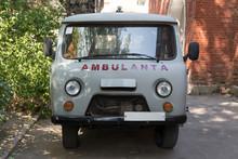 Old Ambulance Van Near The Hospital.