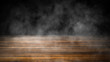 Top wooden table with fog. Wall with smoke on isolated black background. Design element.