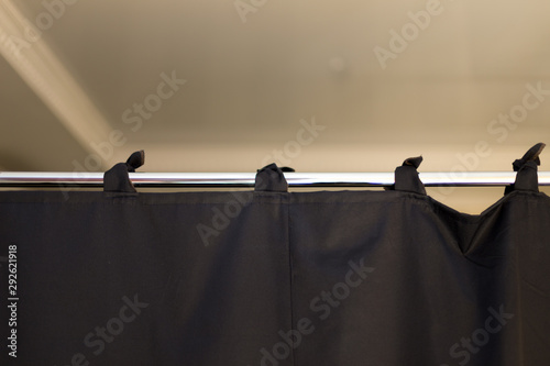 Fotomural black fabric curtains like a partition on a chrome pipe
