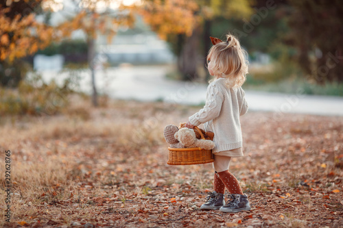 Obraz Little fashionista. Happy girl on autumn day. Little girl happy smiling with autumn leaves. Girls autumn style. Stylish by nature.Little girl excited about autumn season. Autumn warm season pleasant m - fototapety do salonu