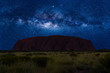 canvas print picture - Spectacular Uluru by night with milky way, stars field and galaxies. Uluru-Kata Tjuta National Park in Northern Territory, Central Australia.