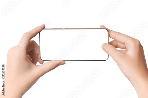 Carta da parati  Woman holds smartphone horizontally in hand with blank screen isolated on white