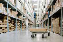 Trolley With Packaging Box In Warehouse Inventory Storage Factory. Logistic Transportation Storehouse Concept.