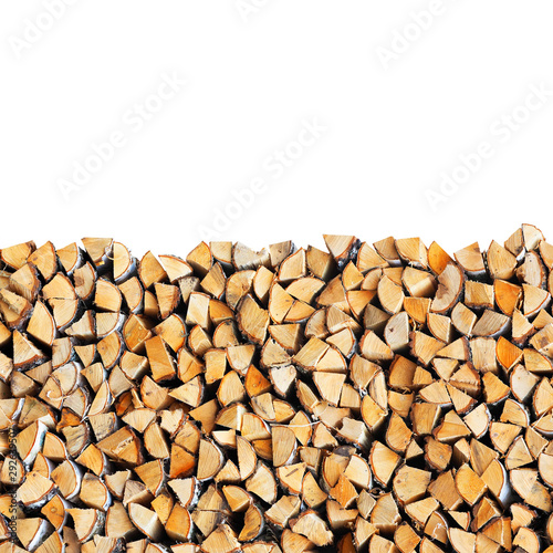 Fotografía Woodpile of birch firewood isolated on white background