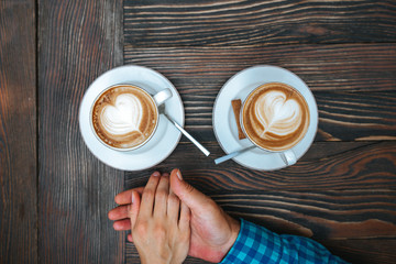 young couple in love drinking coffee on dating