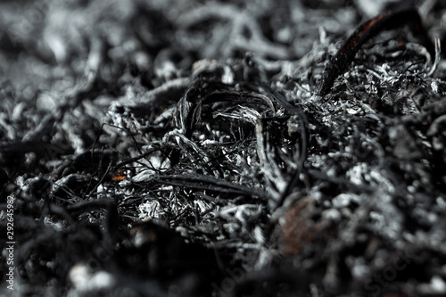 Photo Gray background ashes, burned plants, abstract texture of coals and ashes