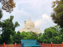 The Great Taj Mahal. Juxtaposition Of The Chair And Taj Mahal. The One Of The Seven Wonders Of World. Contrasting Colors