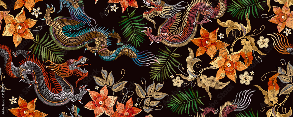 Fototapeta Embroidery asian dragon and beautiful yellow daffodils flowers seamless pattern. Oriental style. Japan and China art