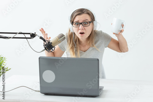 Vászonkép  Radio host concept - Young woman working as radio host at radio station